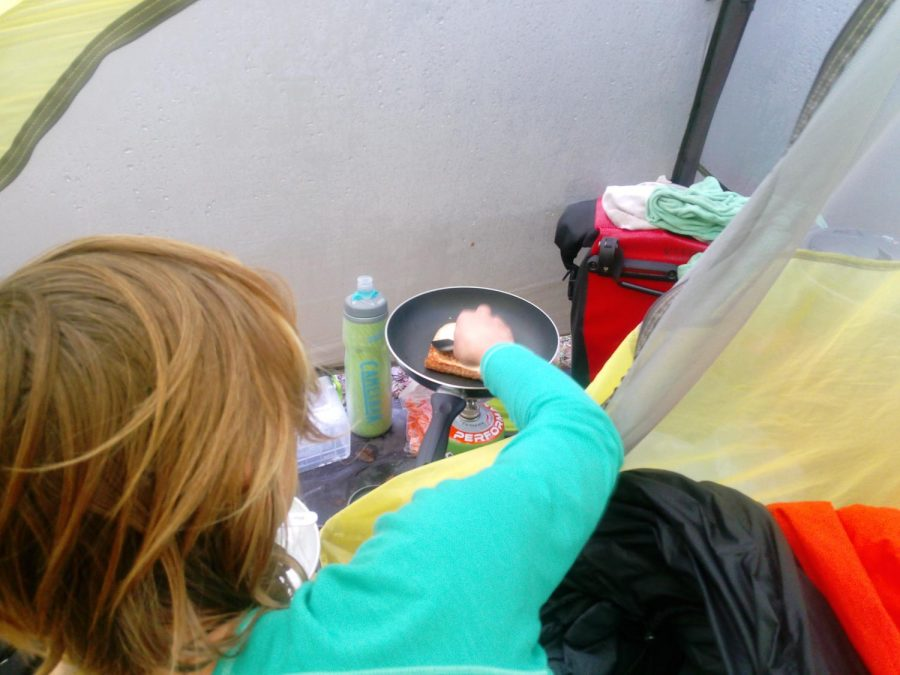 Cold weather camping cooking in tent
