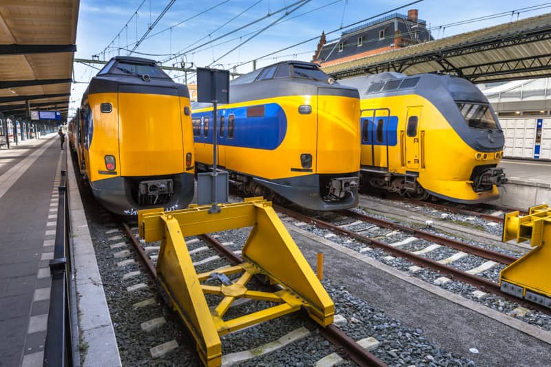 Multiple NS Trains stopping at a Train Station in the Netherlands