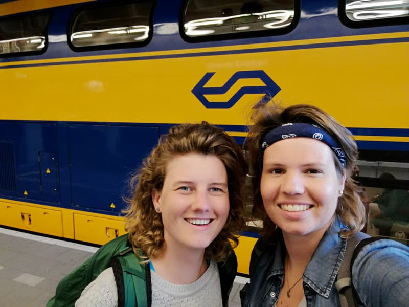 Kelly and Nanet in front of an NS Train on a station in the Netherlands