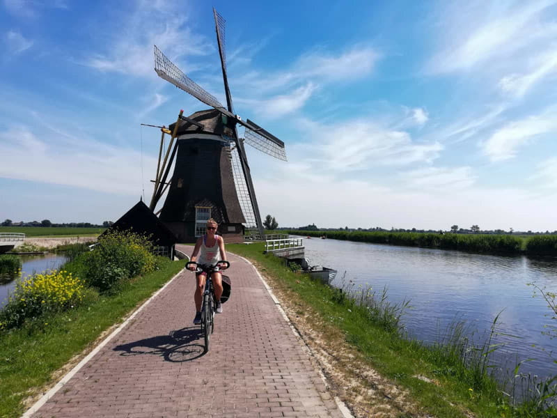 Cycling along Dutch Windmills at Kinderdijk in the Netherlands