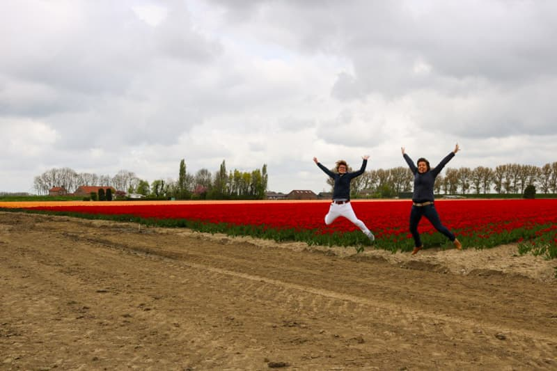 Jumping at the edge of the tulip fields in the Netherlands