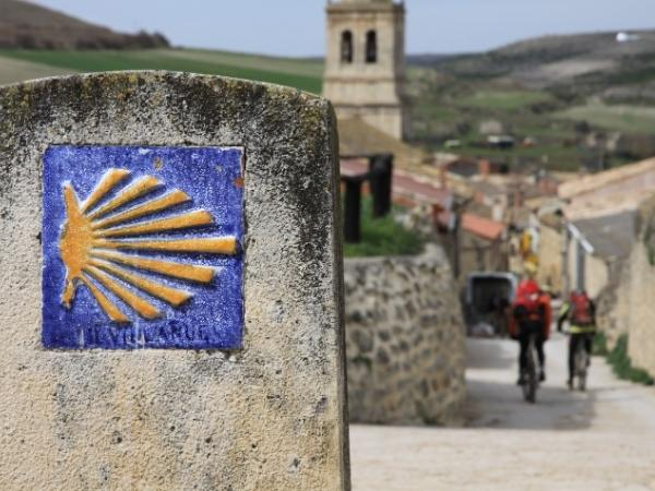Cycling in Spain along a Camino de Santiago sign on the road